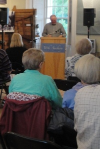 Curator, Dr. T. W. Acheson, speaking at the From Black Bag to High Science exhibit opening at the Fredericton Region Museum.