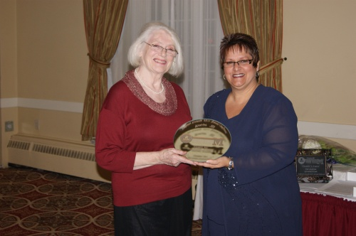 Lyne Bard (left) presenting the Quarter Century Volunteer Award to Elizabeth Earl at the Association Museums New Brunswick awards banquet in Moncton on October 14th.