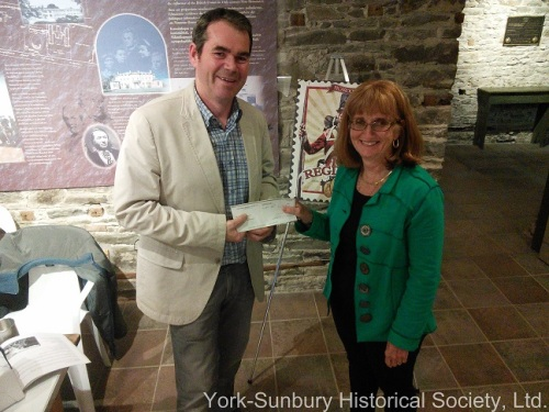 The gift from Sean Dunbar and his brewery, Picaroons, was presented to the York Sunbury Historical Society President, Maxine Campbell, prior to the Annual General Meeting on May 21st.